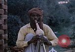 Image of Snake charmer India, 1956, second 4 stock footage video 65675043054