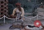 Image of Snake charmer India, 1956, second 45 stock footage video 65675043054