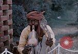Image of Snake charmer India, 1956, second 52 stock footage video 65675043054
