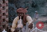 Image of Snake charmer India, 1956, second 54 stock footage video 65675043054