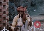 Image of Snake charmer India, 1956, second 56 stock footage video 65675043054