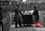Image of Workers unload goods Berlin Germany, 1948, second 50 stock footage video 65675043217