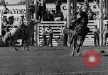 Image of Rodeo show Ellensburg Washington USA, 1935, second 23 stock footage video 65675043350