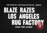 Image of Rug factory on fire Los Angeles California USA, 1955, second 14 stock footage video 65675043377