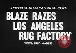 Image of Rug factory on fire Los Angeles California USA, 1955, second 16 stock footage video 65675043377
