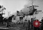 Image of Rug factory on fire Los Angeles California USA, 1955, second 42 stock footage video 65675043377