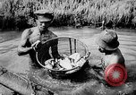 Image of fish farming Dutch Guiana, 1957, second 24 stock footage video 65675043389