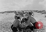 Image of Hitler Youth at beach Poland, 1940, second 18 stock footage video 65675043398
