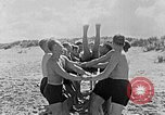 Image of Hitler Youth at beach Poland, 1940, second 19 stock footage video 65675043398