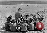 Image of Hitler Youth at beach Poland, 1940, second 27 stock footage video 65675043398