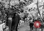 Image of natives in town Ceylon, 1937, second 15 stock footage video 65675043493