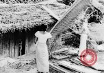 Image of natives in town Ceylon, 1937, second 17 stock footage video 65675043493
