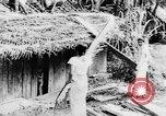 Image of natives in town Ceylon, 1937, second 18 stock footage video 65675043493