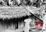 Image of natives in town Ceylon, 1937, second 19 stock footage video 65675043493