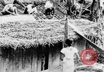 Image of natives in town Ceylon, 1937, second 20 stock footage video 65675043493