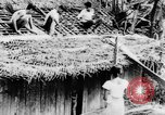 Image of natives in town Ceylon, 1937, second 21 stock footage video 65675043493