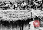 Image of natives in town Ceylon, 1937, second 22 stock footage video 65675043493