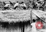 Image of natives in town Ceylon, 1937, second 23 stock footage video 65675043493
