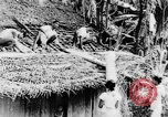 Image of natives in town Ceylon, 1937, second 24 stock footage video 65675043493