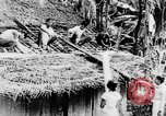 Image of natives in town Ceylon, 1937, second 25 stock footage video 65675043493