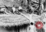 Image of natives in town Ceylon, 1937, second 26 stock footage video 65675043493