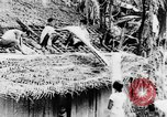 Image of natives in town Ceylon, 1937, second 27 stock footage video 65675043493