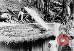 Image of natives in town Ceylon, 1937, second 28 stock footage video 65675043493