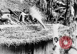 Image of natives in town Ceylon, 1937, second 29 stock footage video 65675043493