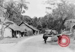 Image of natives in town Ceylon, 1937, second 38 stock footage video 65675043493