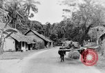 Image of natives in town Ceylon, 1937, second 39 stock footage video 65675043493