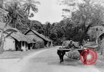 Image of natives in town Ceylon, 1937, second 40 stock footage video 65675043493