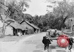 Image of natives in town Ceylon, 1937, second 43 stock footage video 65675043493