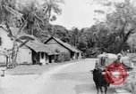 Image of natives in town Ceylon, 1937, second 44 stock footage video 65675043493