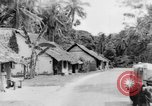 Image of natives in town Ceylon, 1937, second 45 stock footage video 65675043493
