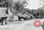 Image of natives in town Ceylon, 1937, second 46 stock footage video 65675043493