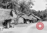 Image of natives in town Ceylon, 1937, second 47 stock footage video 65675043493
