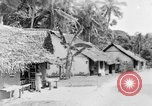 Image of natives in town Ceylon, 1937, second 48 stock footage video 65675043493