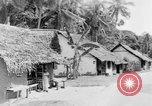 Image of natives in town Ceylon, 1937, second 49 stock footage video 65675043493