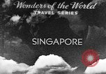 Image of natives in city Singapore, 1937, second 2 stock footage video 65675043495