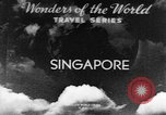 Image of natives in city Singapore, 1937, second 3 stock footage video 65675043495