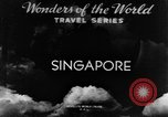 Image of natives in city Singapore, 1937, second 4 stock footage video 65675043495