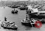 Image of natives in city Singapore, 1937, second 10 stock footage video 65675043495
