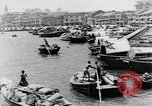 Image of natives in city Singapore, 1937, second 12 stock footage video 65675043495