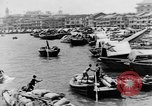 Image of natives in city Singapore, 1937, second 13 stock footage video 65675043495