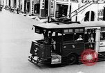 Image of natives in city Singapore, 1937, second 16 stock footage video 65675043495