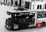 Image of natives in city Singapore, 1937, second 17 stock footage video 65675043495