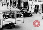 Image of natives in city Singapore, 1937, second 21 stock footage video 65675043495