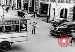 Image of natives in city Singapore, 1937, second 22 stock footage video 65675043495