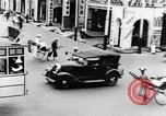Image of natives in city Singapore, 1937, second 23 stock footage video 65675043495