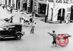 Image of natives in city Singapore, 1937, second 24 stock footage video 65675043495